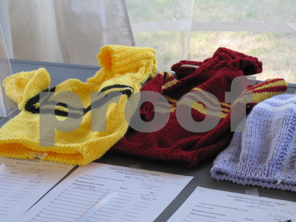 Handknit sweaters were one of the many items in the silent auction at the Legends Tailgate event.