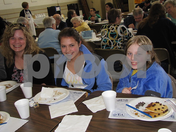 Lisa Shimkat, Laura Nerlich, and Leah Schorzmann at the Noon Kiwanis Pancake Day fundraiser.