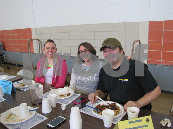 Amber Malcich, and Megan and Brandon Peterson enjoy the hearty pancake breakfast at the Noon Kiwanis fundraiser.