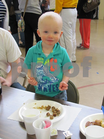 William Gubbels found it easier to stand to tackle his big breakfast of pancakes and sausage at the Noon Kiwanis fundraiser.