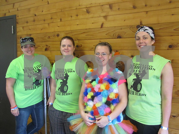 Abbi Telford, Heather Kimbrough, Taria Brandt, and Jessica Schade of the team 'Dakota City Demolition Crew'.