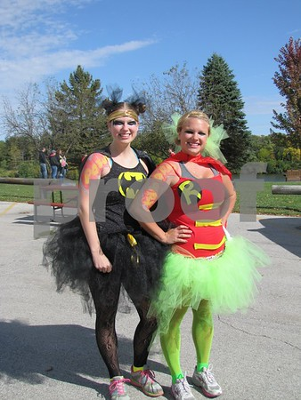 Stacy Lennon and Amanda Breeser are about to start their 7th 5K in their tutus.