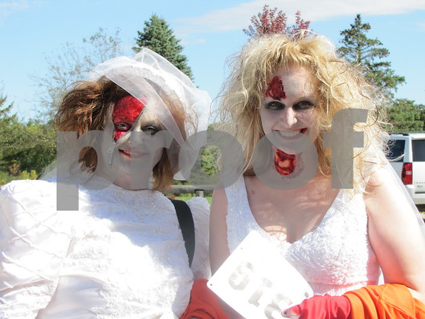 Heather Dailey-Iverson and Kristi May in their scary Halloween bride costumes.