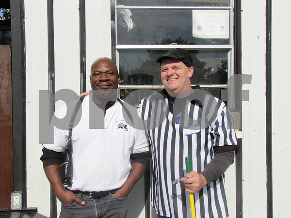 Cornell Lowery, The Barbecue Thief, and his assistant Breck Johnson in front of Lowery's trailer.  The Barbecue Thief was cooking up BBQ sandwiches and hot dogs for participants and for sale to spectators.