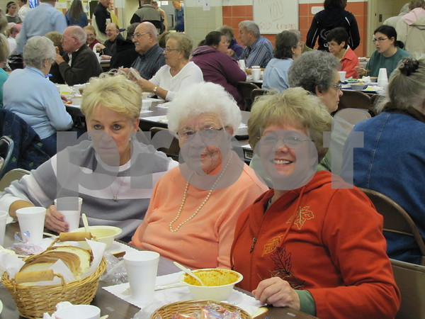 Kay Jensen, Joan Jankins, and Sandy Wills enjoy the soup supper for the Golden Kiwanis' fundraiser.