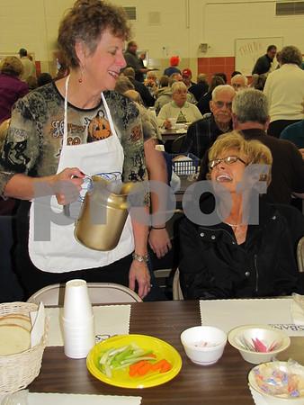 Connie Gustason serving Jan Friederichs at the Golden Kiwanis' Soup Supper fundraiser.