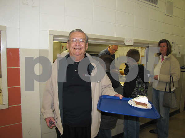 Don Nordstrom is all smiles after receiving his slice of homemade pie at the Soup Supper fundraiser put on by the Golden Kiwanis.