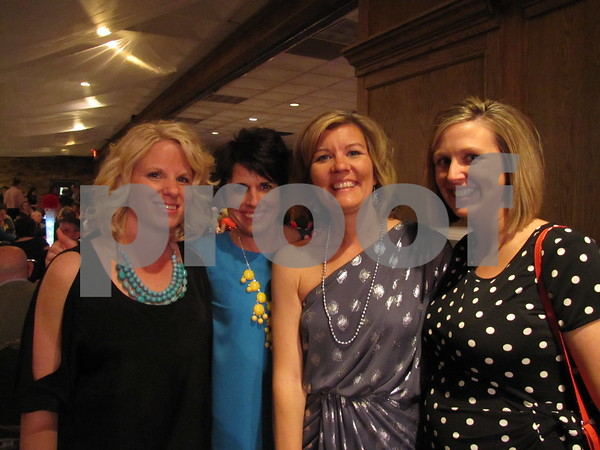Susan Laufersweiler, Kim Gales, Susan Doyle, and Megan Heesch attended the St. Edmond Ball at the Best Western Starlite.