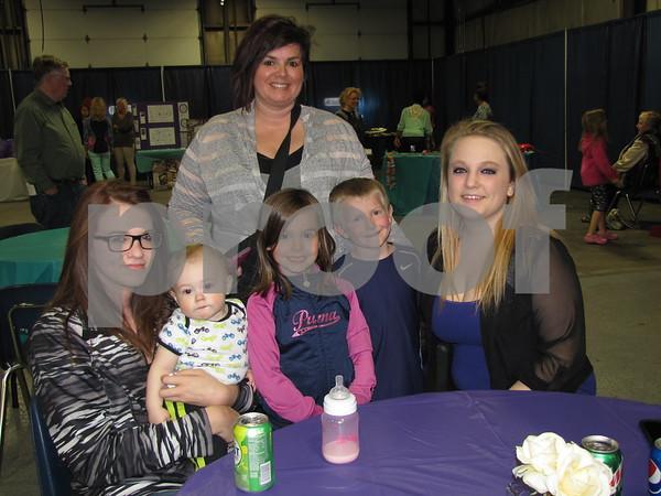 Lisa Moore (standing), Sierra Lamirande holding Dakota Vaughn, Emma Moore, Gavin Moore, and Easton Craig attended the fundraiser for DSAOC.