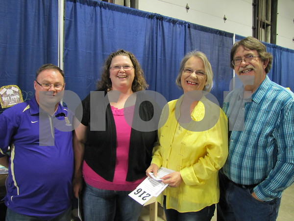 Kevin and Lisa Brown, and Lorraine and Curt McCoskey looked over the items they may bid on.
