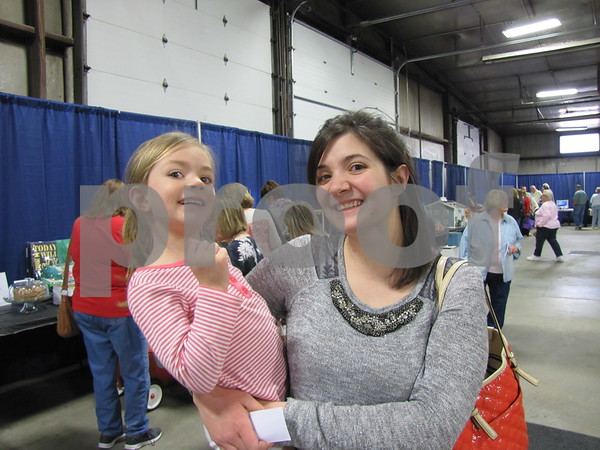 Ashley Ahrens and her daughter Olivia were looking over the many silent auction items.