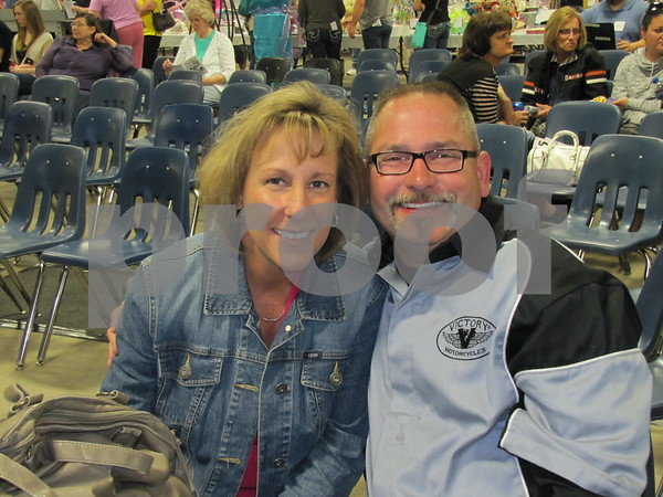 April and Larry Schuster waiting for the live auction to begin.
