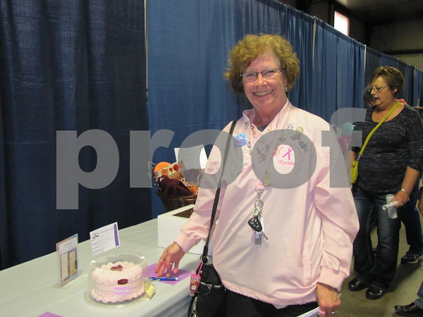 Wyn Tighe was eying a delicious looking pink cake.