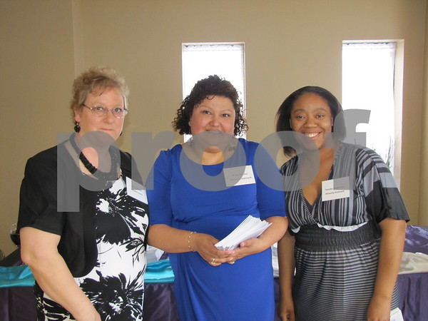 Nancy Kuebler, Pattie Ritchie, and Tameka McKenney, volunteers with D/SAOC, greet attendees to the cake auction.