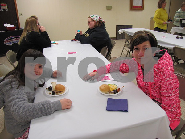Kennedie and Monica Radke enjoy the meal before the live auction began.