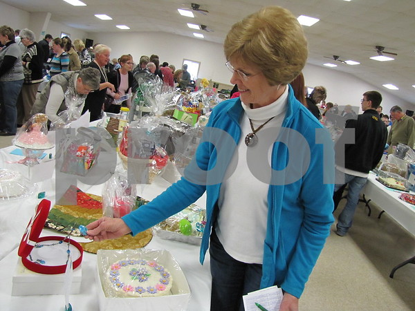 Pat Bennett looks over the many items up for auction at the D/SAOC cake auction.