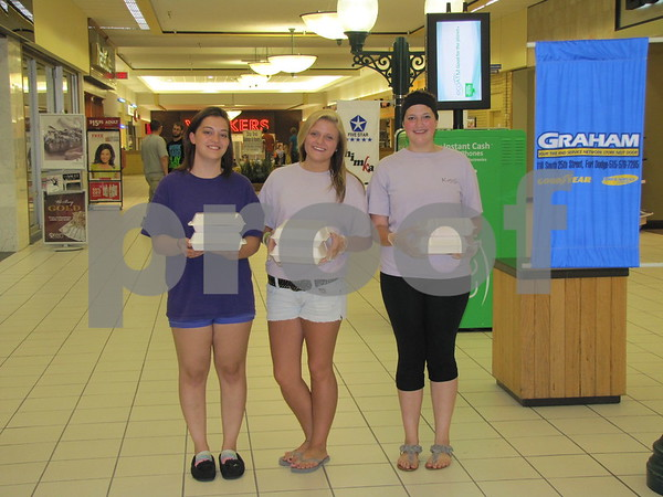Kayla Owens (daughter of Candi), Emily Cooper, and Kayla Douglas strolled through the Crossroads Mall selling cupcakes for 'Sweets by Candi & Company' with proceeds going to support Patterson baseball field.