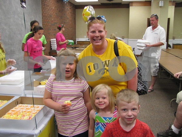 Tabitha Johnson and children Lilly, Ella, and Eli showed their support for Patterson field by purchasing cupcakes from 'Sweets by Candi & Company'.