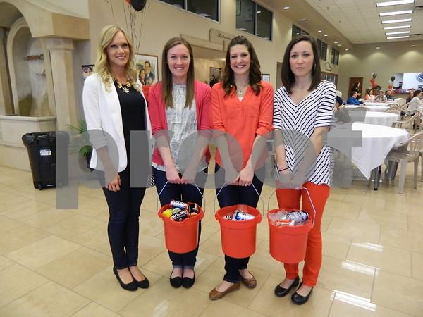 Left to right: Abigail Jones, Maggie Carlin, Carissa Miller, and Alex Doyle. (Junior women's club volunteers)