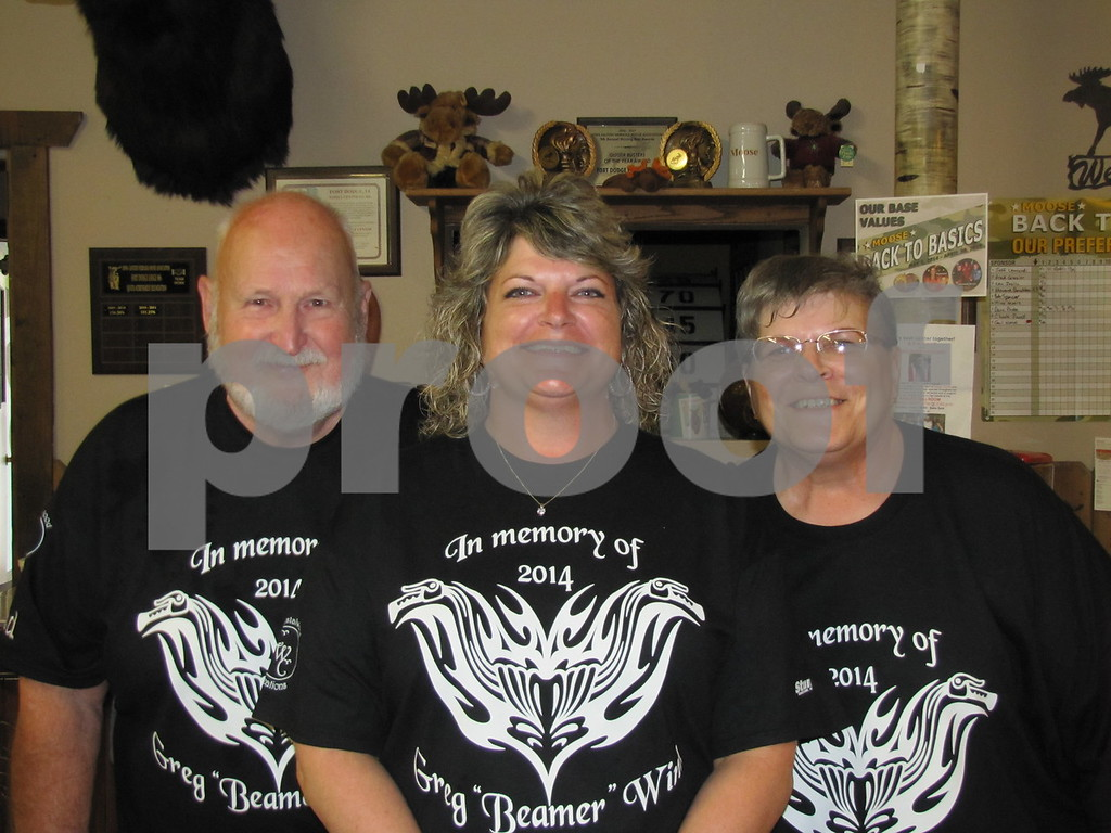 Ray Winn, Dawn Donnelly, and Sharon Winn. Donnelly is the daughter of Ray and Sharon Winn.