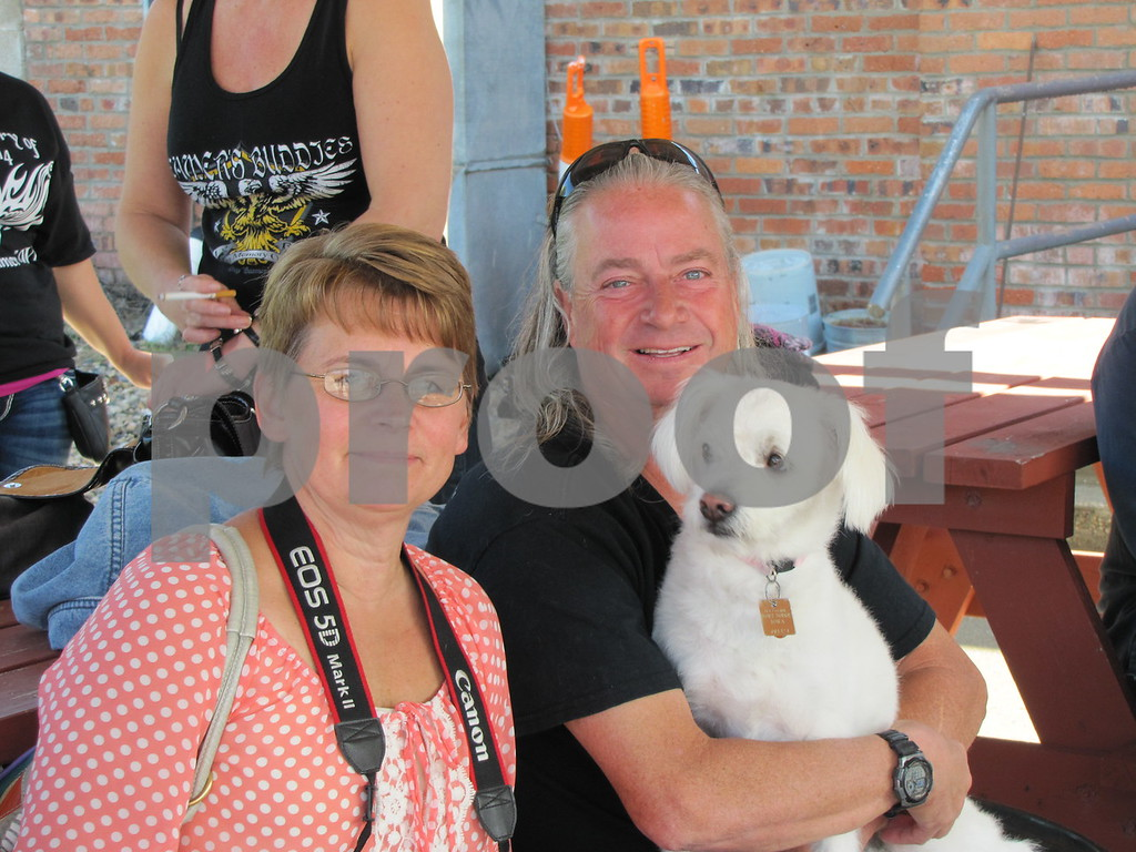 Sherry and Craig Gibbons with their dog Ellie Mae.