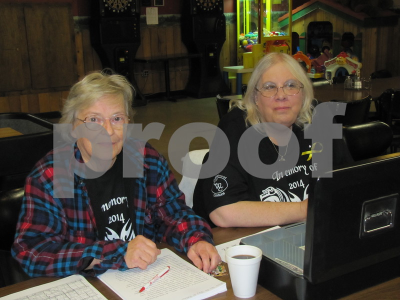 Eileen Brennan and Cindy Larson register participants.
