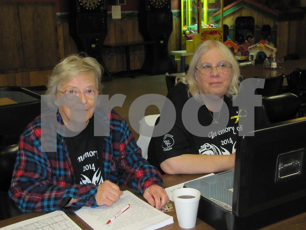 Eileen Brennan and Cindy Larson register participants.