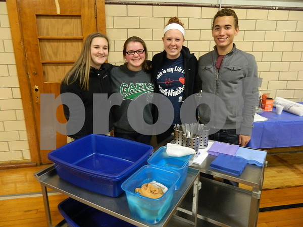 left to right: Maddie Nemmers, Meghan Hanley, Hannah Schaeffer, and Devin Camamo