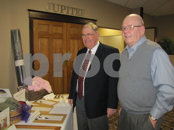 Rod Poppinga and Leroy Hartquist look over the many items in the silent auction.