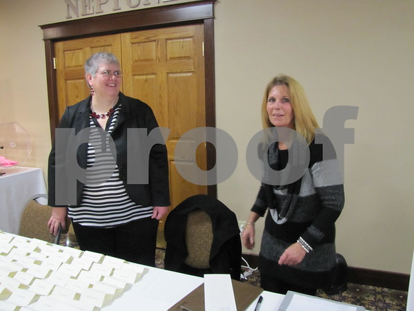 Brenda Sinnett and Laura Gurnett prepare for guests to arrive at the annual Hospice Ball.