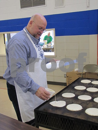Rob Hughes of Noon Kiwanis running the griddle at the annual Pancake Day.