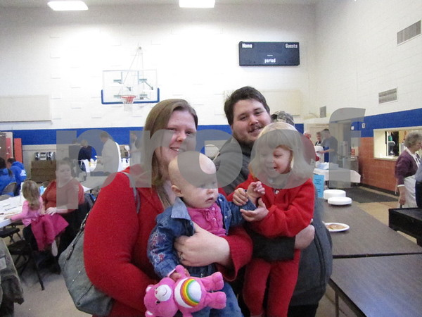 Jennifer and Brandon Mcatee with daughters Evie and Iris in line for breakfast at the annual Kiwanis Pancake Day.