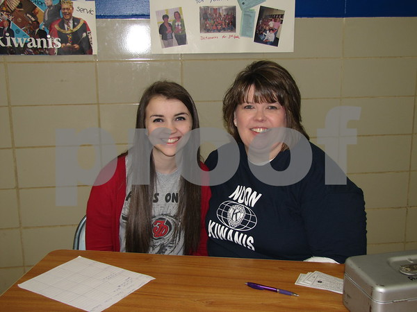 Natalie Cravens and her mom, Janelle Cravens, member of Noon Kiwanis, greet and sell tickets at the annual Kiwanis Pancake Day held at Community Christian School.