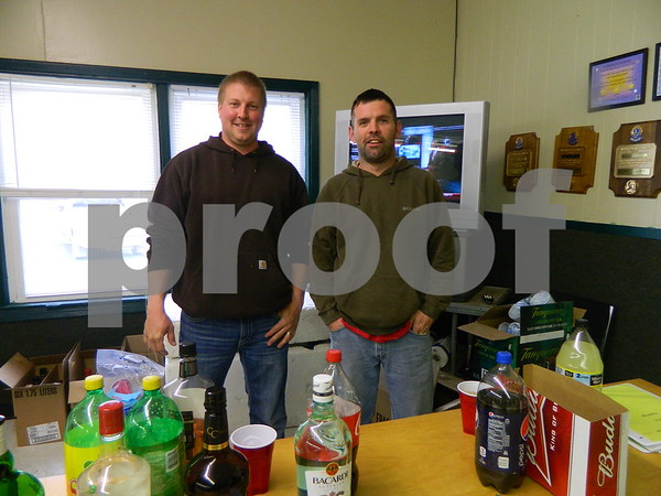 Right to left: Mike Reekers and Jason Doile serving drinks.