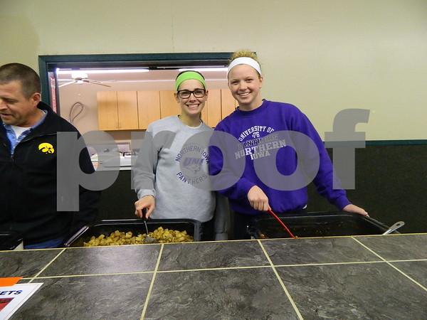 Right to left: Lydya Harvy and Theresn Doyle helping serve food at he steak fry.