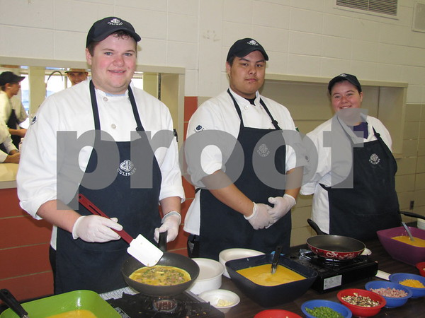 Iowa Central Culinary Arts students Cody Sayers, Randy Ramos, and Karmen Zeka served omelets at YSC's fundraiser.