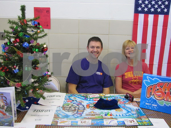 Steve Paukert and Deb Brown, employees of Kohl's, volunteered their time at the fundraiser for Youth Shelter Care's Omelet Breakfast with Santa.  They were selling a board game produced by a group of local fisherman to help raise funds.