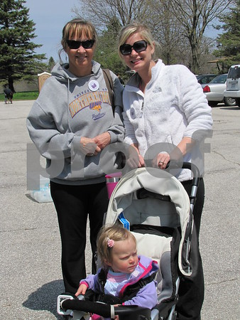 Brenda Axness and Chelsea Maier with Harper Maier in the stoller were walking in the benefit for Justin Axness of Opportunity Village.