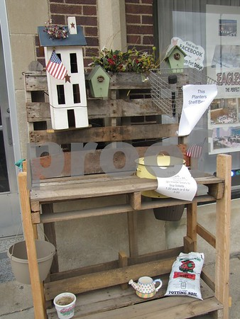Gardening bench to be raffled off at the celebration.