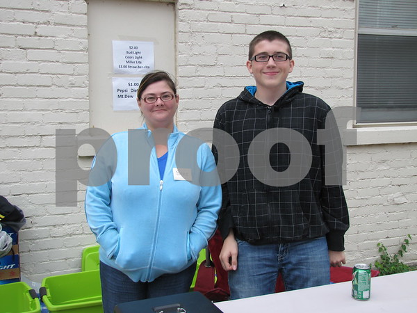Barb Evans and Trent Leners work the beverage stand at the Eagles 45th Anniversary Celebration held in the courtyard.