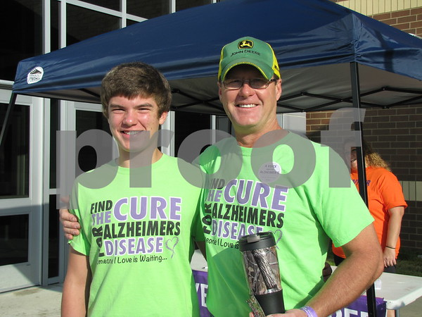 AJ and Eric Larson pose before walking to raise funds for Alzheimers.