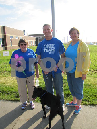 Linda Opheim with Jim and Rhonda Guldenpfennig and their dog 'Mo' before the walk.