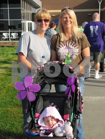 Brooke Freitag and Cindy Schoenfisch with Natalie Freitag in the stroller.