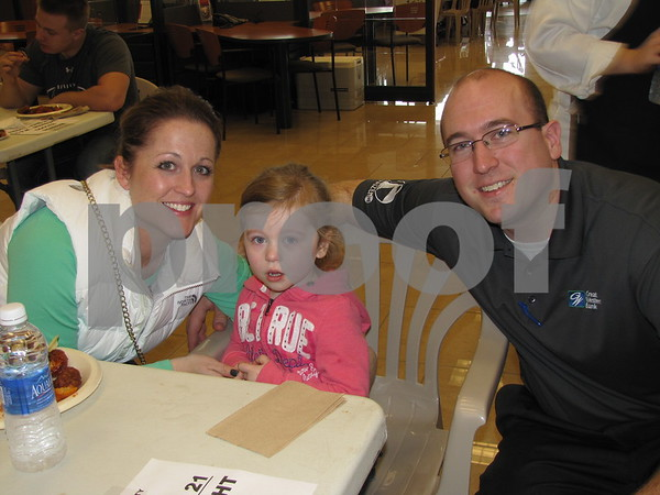 Jamie, Sophia, and Craig Schlienz show their support at the 'Wing It' event to raise money for Relay For Life.