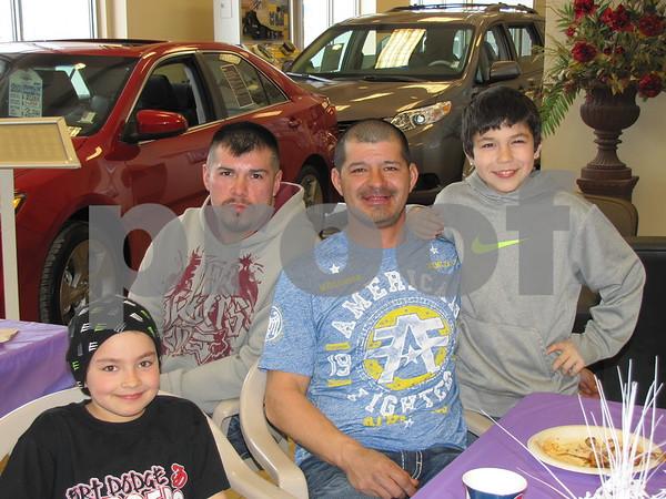 Thomas Prine (rear), Martyne, Mike, and Taj Lowrey.