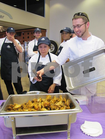 Iowa Central Community College culinary students and their instructor show off their wings.