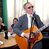 David Lippman as George Shrub, singing CIA agent, entertains at the Brooklyn For Peace Spring fundraiser at Madiba Restaurant.