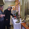 Looking at photos and collectables from Fr. Joe's life