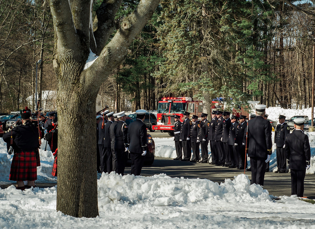 """. The funeral procession of Fitchburg Firefighter Jack Mulcahy makes its way to Our Lady of the Lake Church in Leominster on Monday, March 20, 2017. Jack \""""Mulky\"""" Mulcahy, who served 41 years on the department, died Wednesday, March 15, after a 16-month battle with pancreatic cancer. He was 63. SENTINEL & ENTERPRISE / Ashley Green"""