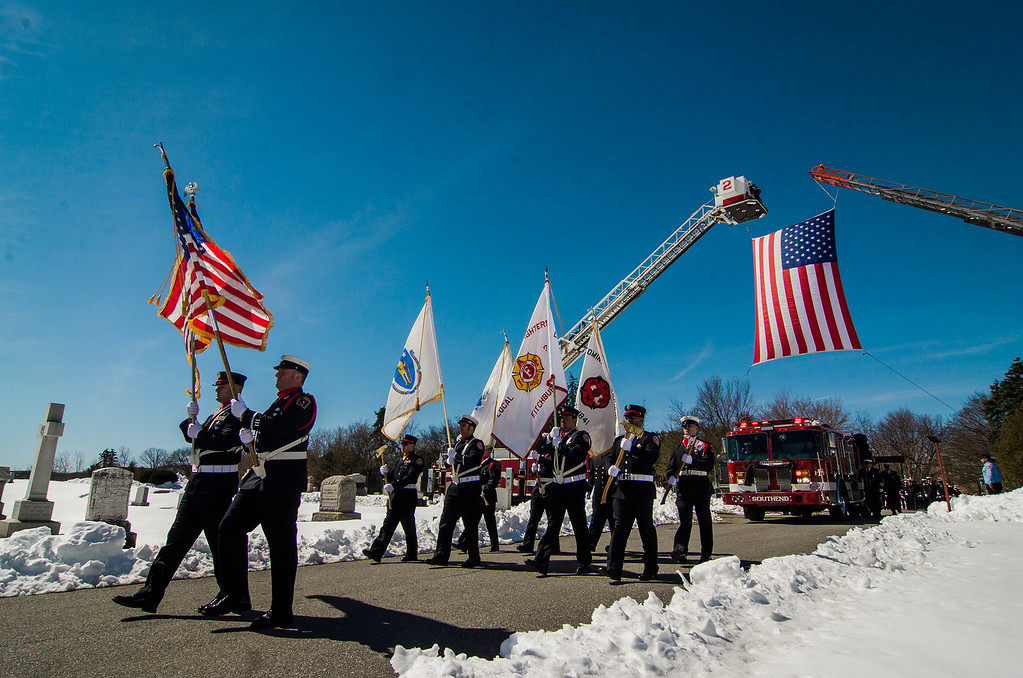 """. The funeral procession of Fitchburg Firefighter Jack Mulcahy arrives at St. Bernard\'s Cemetery in Fitchburg on Monday, March 20, 2017. Jack \""""Mulky\"""" Mulcahy, who served 41 years on the department, died Wednesday, March 15, after a 16-month battle with pancreatic cancer. He was 63. SENTINEL & ENTERPRISE / Ashley Green"""